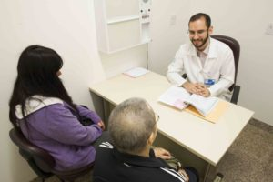 Doctor consults with patient and family